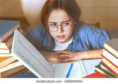 Stressed college student tired of hard learning with books in exams tests preparation, overwhelmed high school teen girl exhausted with difficult studies or too much homework, cram concept