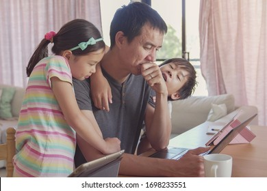 stressed father working from home with children. Homeschooling, stay home, social distancing during coronavirus quarantine isolation, freelance job, new normal concept