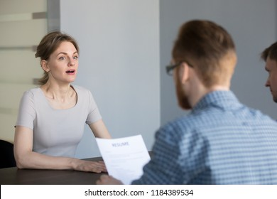 Stressed female applicant feels surprised at job interview, nervous vacancy candidate in panic confused by unexpected question shocked with result at hiring negotiation or stunned by bad impression
