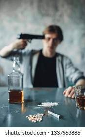 Stressed junkie put a gun to his temple