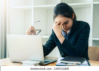 Stressed lawyer business women working and writting in notebook on desk at office. consultant lawyer, justice and law ,attorney, court judge, concept