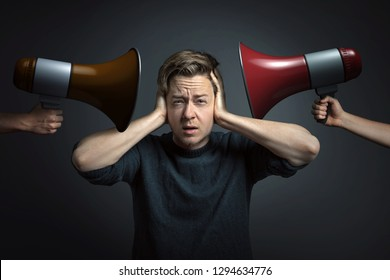 Stressed man covers his ears