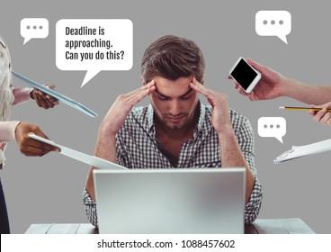 Stressed man in office working for deadline under pressure