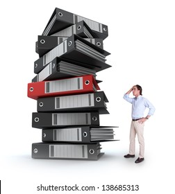 Stressed man overwhelmed by a huge pile of files