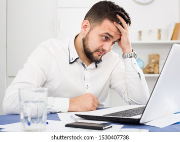 Stressed man worker facing challenge in project in office