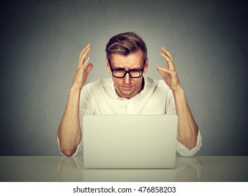 Stressed man working on computer. Negative human emotion face expression