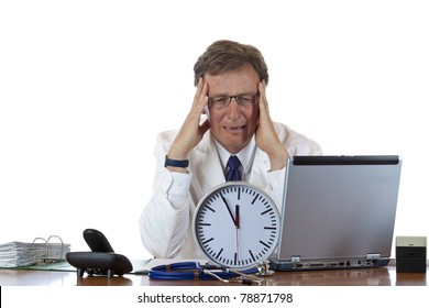 Stressed medical with clock in front has headache out of time pressure. Isolated on white background.