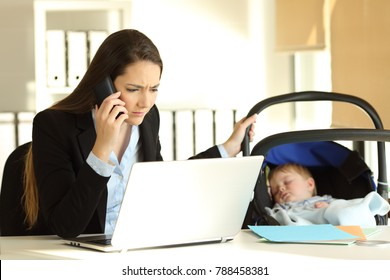 Stressed mother working attending a phone call and taking care of her baby at office