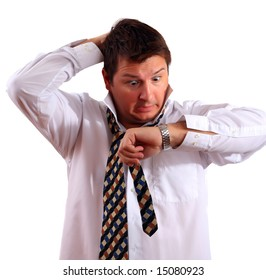 Stressed up office worker or a businessman late for work looking at his watch