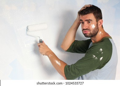 Stressed out male painting his home with space for copy