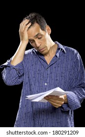 stressed out man reading unpaid bills or taxes