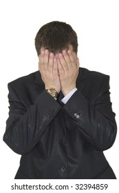 Stressed out young business man over white background