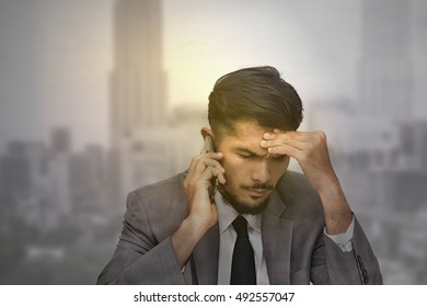 Stressed over time working hard all night businessman with cityscape blurred background