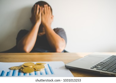 Stressed person covering his face after bitcoin investment is failure and he was bankrupt.