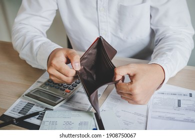 Stressed, Problem business person man, male holding and open an empty wallet not have money, credit card, not to payment bill, loan or expense in pay. Bankruptcy, bankrupt and debt financial concept.