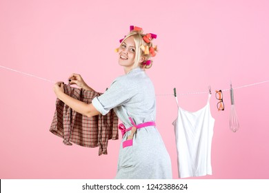 stressed retro housewife. Maid or housewife cares about house. Vintage housekeeper woman. Busy mother. Multitasking mom. Performing Different Household Duties. Every day chores.