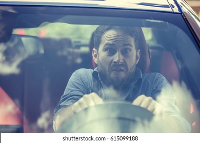 Stressed scared young man driver. Inexperienced anxious motorist concept