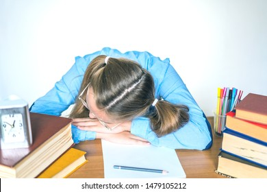 Stressed school girl tired of hard learning with books in exams tests preparation, overwhelmed high school teen girl exhausted with difficult studies or too much homework, cram concept