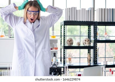 Stressed scientist got headache with her lab results in science lab. Failed science researcher having problem analyzing medicine related innovation. Stressed scientist  & medical researcher concept.