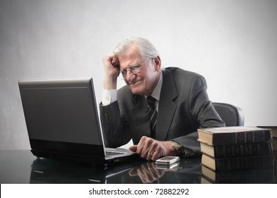 Stressed senior businessman in front of a laptop