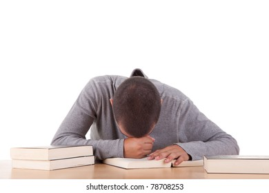 Stressed student laying on desk over white background.
