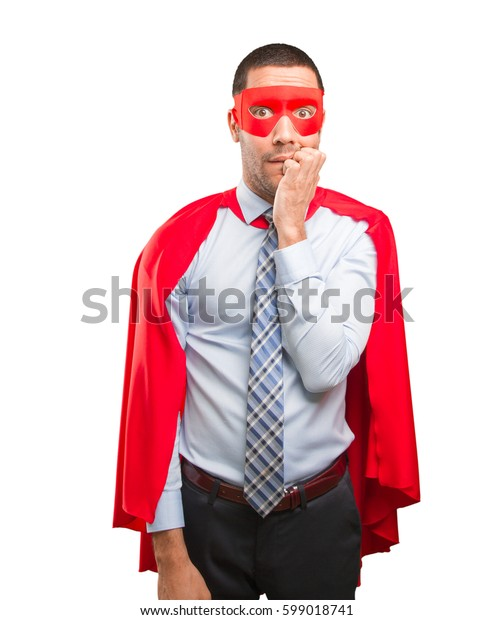 Stressed super businessman posing