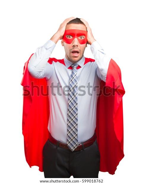 Stressed super businessman posing