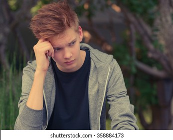 Stressed teenager boy outdoors