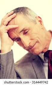 Stressed and tired mature businessman.