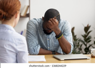 Stressed upset african applicant incompetent intern feel afraid disappointed at hiring negotiation, unprepared black candidate depressed about rejection bad first impression on failed job interview