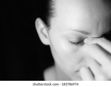 Stressed woman (black and white portrait).