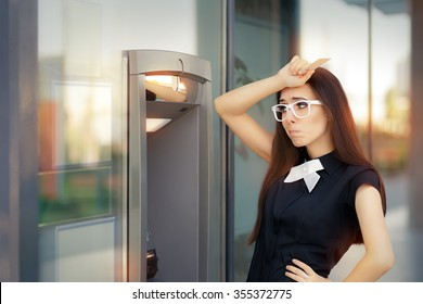 Stressed Woman with credit card at ATM - Funny broke businesswoman checking account balance