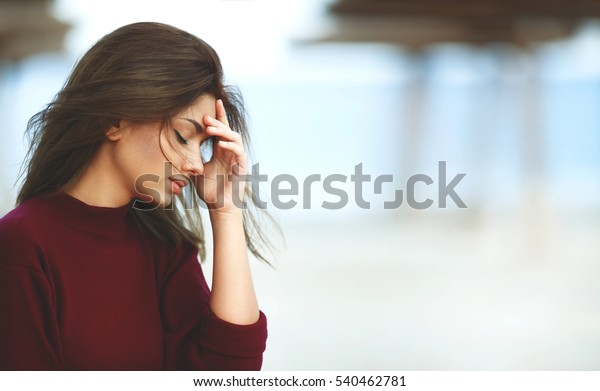 Stressed Woman with Headache on the Beach. Outdoor Sad Woman
