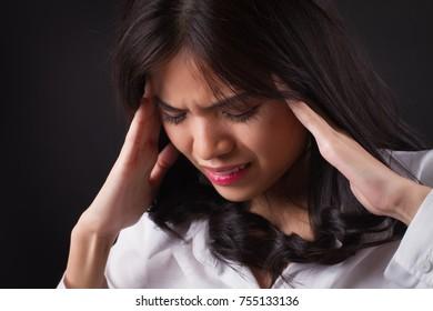 stressed woman with headache, vertigo, dizziness, migraine, hangover