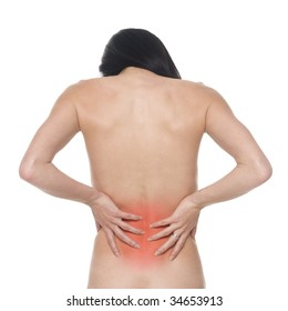A stressed woman holding her painful lower back.