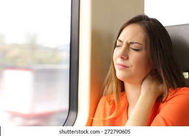 Stressed woman with neck ache sitting in a train wagon complaints