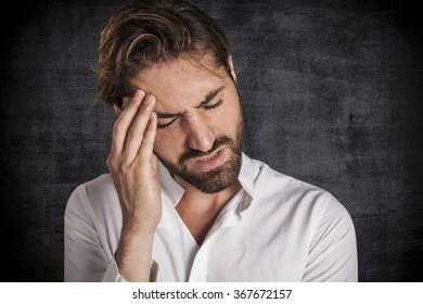 Stressed young businessman with hand on the head