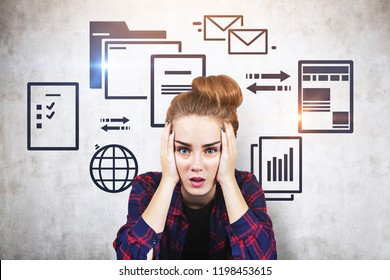 Stressed young woman in checkered shirt sitting near concrete wall with electronic documents and internet icons. Concept of information overload. Toned image