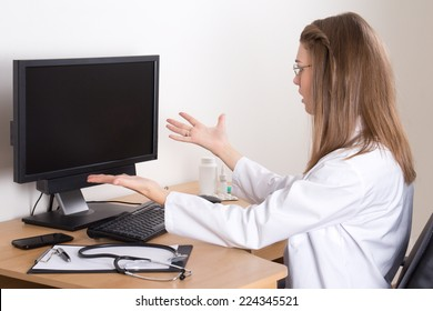 stressed young woman doctor in her office