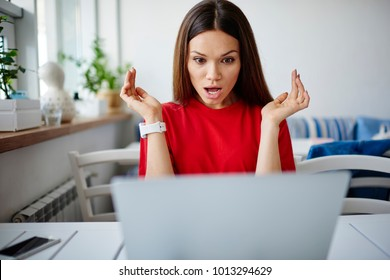 Stressed young woman shocked with fail of software during update on laptop computer,impressed hipster girl getting bad surprise with receipt for internet connection while checking mail on netbook