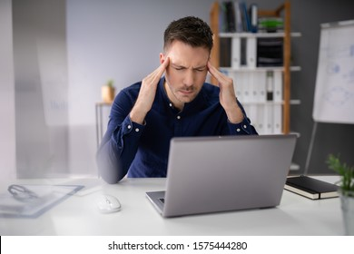 Stressful Business Man Working On Laptop In Office