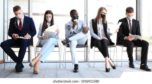 Stressful business people waiting for job interview with face mask, social distancing quarantine during COVID19 affect