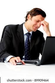 Stressful businessman trys to massage his tension headache away