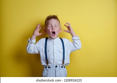 Stressful child. Sad and unhappy child. Upset toddler boy. problem child with head in hands. Cute boy shouts. Stressed child. boy shouting on yellow background.
