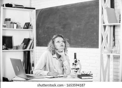 Stressful scientist. Stressful educator. Teacher stressful occupation. Pressure nervous tense. Girl tired stressful expression with laptop and microscope working investigation biology and chemistry.