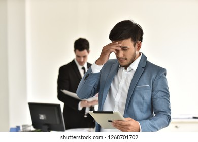stressful situation.Young businessmen stressed with irrelevant work. And try to find a way to solve problems. It was a mistake. In a stressful situation.In a stressful situation.