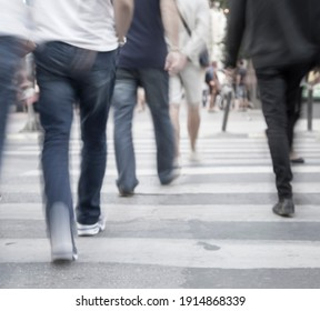 Stressful spaces, filtered blur abstract people background, unrecognizable silhouettes of people walking on a street
