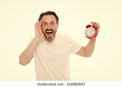 Stressful times. Man bearded mature guy hold clock isolated on white. Man with beard check what time is it. Time management skills. Personal schedule and daily regime. Alarm clock morning time.
