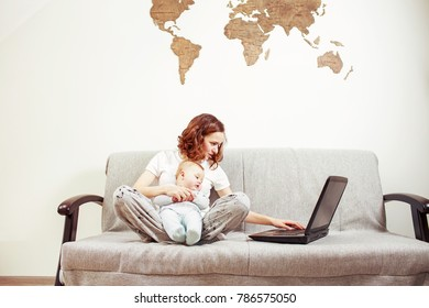 Stressfull young woman with baby and laptop at home. Working mom concept