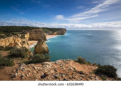 Stretch of the Algarve coastline and beaches from the Ponta do Altar promontory in Ferragudo, Algarve, Portugal; Concept for travel in Portugal and Algarve
